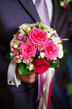Flowers roses in hand of groom Royalty Free Stock Images