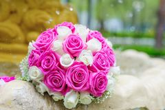 Flowers roses wedding bouquet in fountain sprays water droplets Stock Photo
