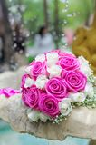 Flowers roses wedding bouquet in fountain sprays water droplets Royalty Free Stock Image