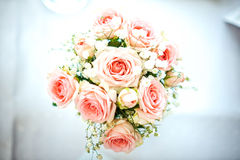 Flowers of roses on wedding table with card, romantic pink background for party or event Stock Images