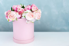 Flowers in round luxury present box. Bouquet of pink and white peonies in paper box. Mock-up of hat box of flowers with Stock Photo