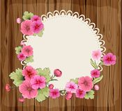 Flowers on a round napkin and wooden background Royalty Free Stock Photo