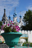 Flowers in russian traditonal medieval monastery. Bright flowers in medieval monastery in old russian town Murom Royalty Free Stock Photo