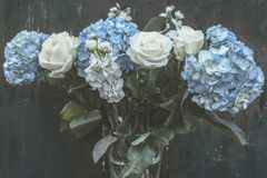 Flowers. Rustic background with some pretty seasonal flowers Royalty Free Stock Image