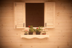 Flowers on rustic window Royalty Free Stock Image