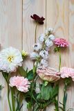 young flowers on rustic wooden boards background flat lay top view royalty free stock image