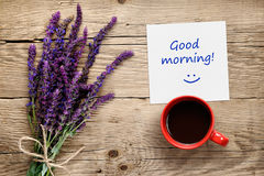 Flowers of salvia, coffee cup and paper with Good morning text on table Royalty Free Stock Photos