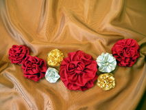 Flowers on satin Stock Photography