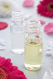Flowers and scent bottle. Close up crop of flowers and scent bottle royalty free stock photo