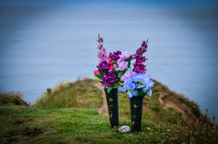 Flowers on the sea shore in remembrance Stock Images