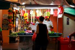 Flowers seller at night market in Singapore Royalty Free Stock Photography