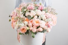 Flowers set. beautiful luxury bouquet in woman hand. the work of the florist at a flower shop. white round box. Flowers set. beautiful luxury bouquet in woman stock image
