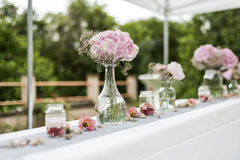Flowers settings decoration outdoor setup for wedding with pink colored flower Royalty Free Stock Photography