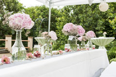 Flowers settings decoration outdoor setup for wedding with pink colored flower Stock Photography