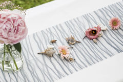 Flowers settings decoration outdoor setup for wedding with pink colored flower Stock Image