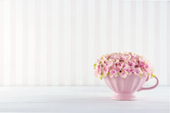 Flowers in a shabby chic mug Royalty Free Stock Images