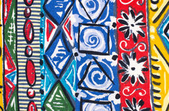 Flowers and shapes on colorful fabric. Abstract flowers and geometric shapes print as background Stock Image