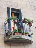 Flowers on Sienna Balcony, Italy Stock Photo