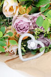 Flowers with silver heart Stock Images