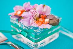 Flowers with slices of fish in a glass dish Royalty Free Stock Photo