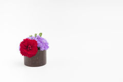 Flowers in small vase on a white background Stock Photo