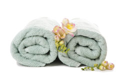 Flowers on spa towels Stock Photos