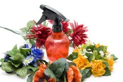Flowers and spraying bottle Royalty Free Stock Photos