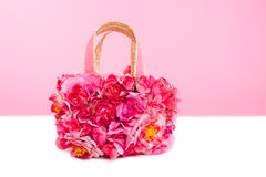 Flowers spring bag in pink and red roses on white Royalty Free Stock Images