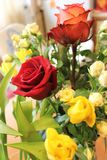 Flowers. Spring bouquet of red roses and yellow tulips Stock Photos