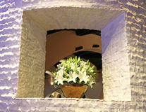 Flowers. Square hole in the wall decorated with flowers Stock Photo