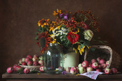 Flowers. Still life with flowers and apples Royalty Free Stock Images