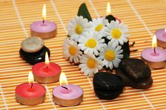 Flowers, stones and candles  f. Flowers, stones and candles for spa treatment Royalty Free Stock Images