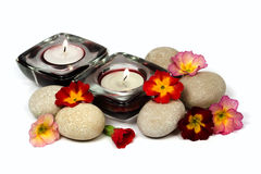 Flowers, stones and scented candles Royalty Free Stock Photography