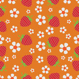 Flowers and strawberries on orange background. Stock Photography