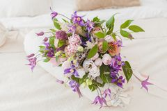 Flowers surprise on the bed. Stock Photo