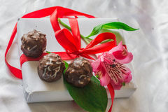 Flowers and sweets. Flowers and candy are at present Stock Photography