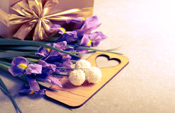 Flowers, sweets and gift box Stock Image