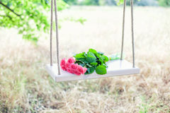 Flowers on a swing Royalty Free Stock Photo