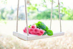Flowers on a swing Stock Photo