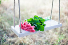 Flowers on a swing Royalty Free Stock Photography