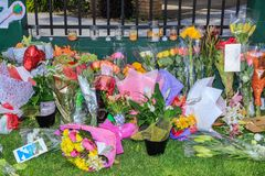 Flowers, sympathy cards and candles laid at mosque after shootings in Christchurch, New Zealand. Tauranga, New Zealand - March 16 2019: Floral tributes and cards stock photo