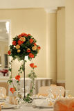 Flowers on the table. A beautiful bouquet of flowers on the table, ballroom indoor Stock Photos