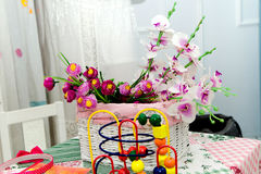 Flowers on the table in chidren room. Photo of flowers on the table in chidren room Royalty Free Stock Image
