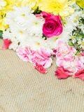 Flowers on table of flower decoration arrangement. Royalty Free Stock Photo