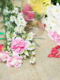 Flowers on table of flower decoration arrangement. Royalty Free Stock Photography