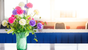 Flowers on a table in the library Royalty Free Stock Photos