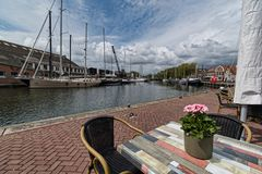 Flowers on the captains table in the port of Enkhuizen stock photography