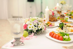 Flowers on Table in Restaurant Stock Images