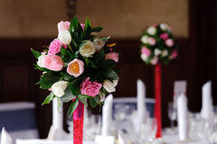 Flowers on table at wedding. Flower decorations at wedding reception Royalty Free Stock Image