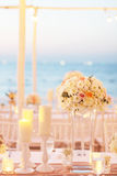 flowers on table in wedding on the beach with Sunset Royalty Free Stock Photo